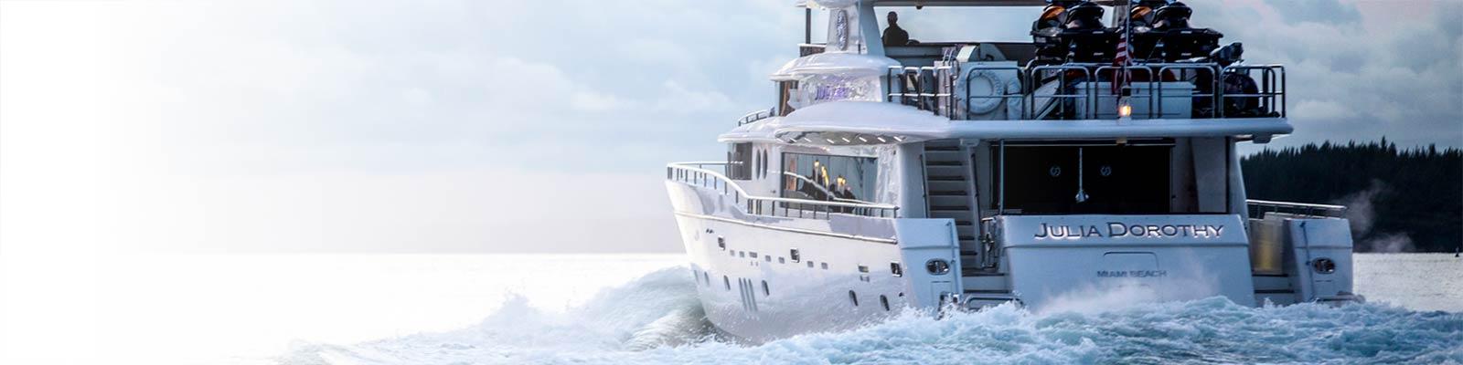 Luxury yacht leaving port.