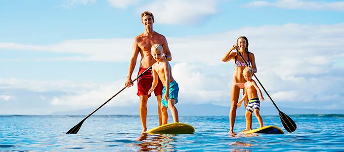 Family on paddle boards