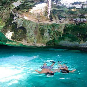 Couple snorkeling in Thunderball grotto