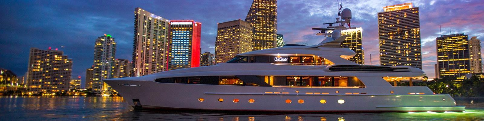 Luxury yacht with Miami skyline in background